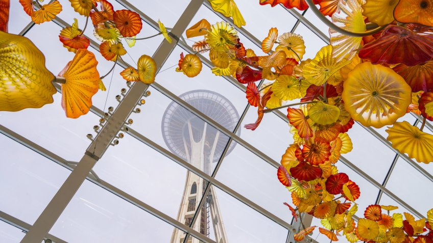 SEATTLE - Apr 26, 2016: Blown glass in abstract shapes in red and yellow, Chihuly Garden and Glass Museum, Seattle, Washington.