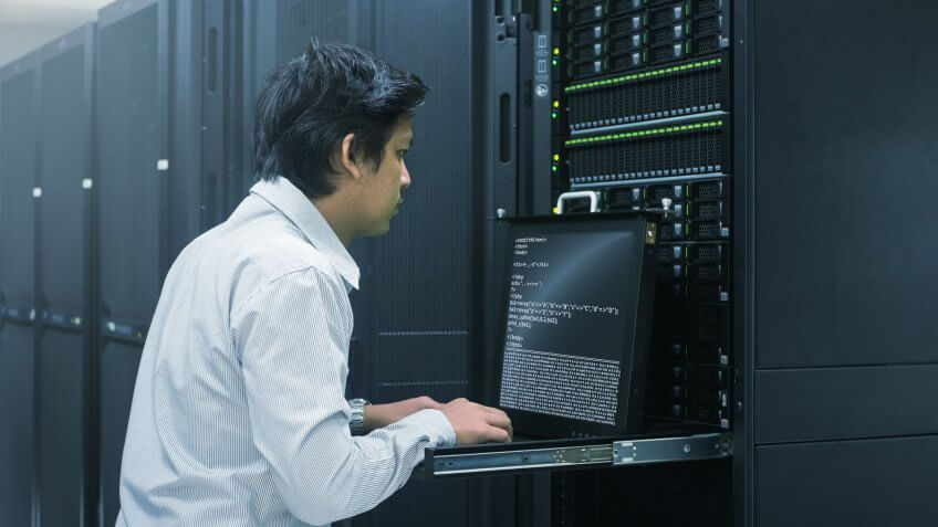 Administrator working in data center.