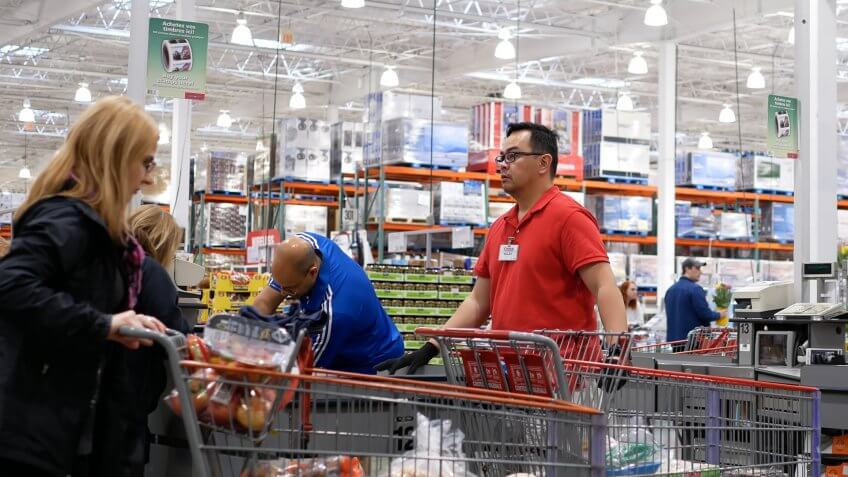 Costco worker stocking product
