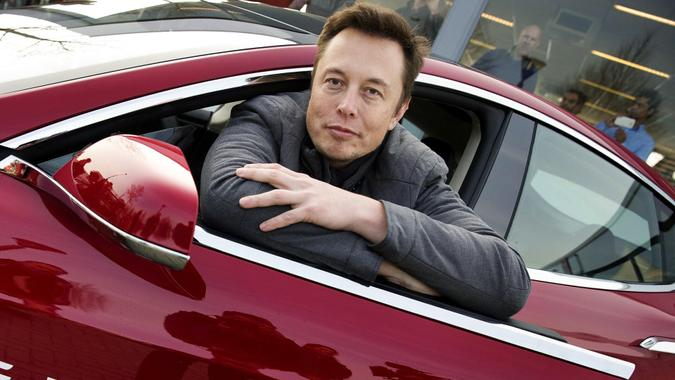 Elon Musk Co-founder and Ceo of Tesla Poses with a Model of the Brand During a Visit to Amsterdam the Netherlands 31 January 2014 the European Tesla Service is Based in Tilburg and the European Headquarters in Amsterdam Netherlands AmsterdamNetherlands Transport Tesla - Jan 2014.
