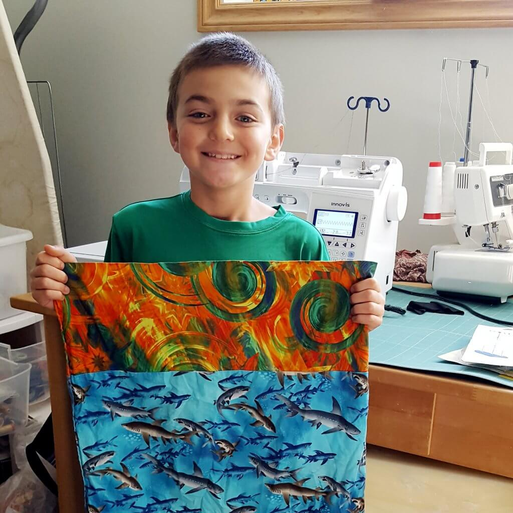 nine-year-old Gabriel Roberge with pillow case