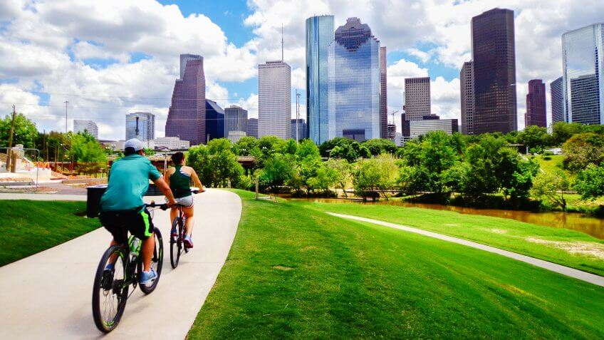 people riding along pathway in Houston Texas