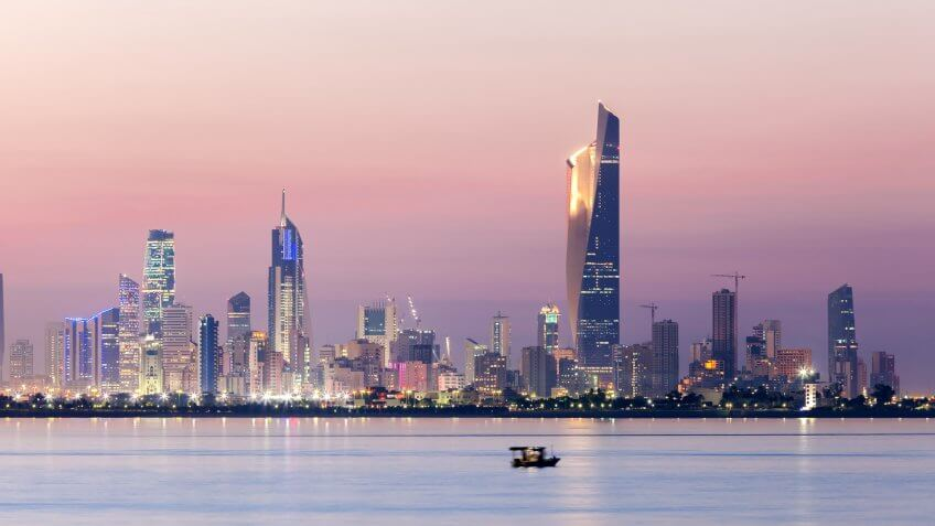 Skyline of Kuwait city at night.