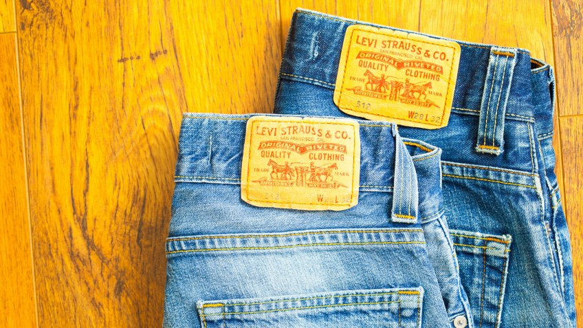 Moscow, Russia, February 06, 2015: close up of the Levis yellow label on the back pocket of a two pair of denim jeans.
