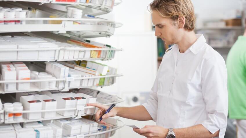 Pharmacy technician searching for prescription pills