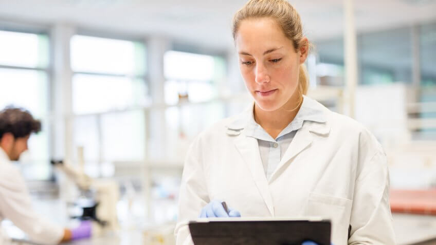Occupational Health and Safety working with a digital tablet in the laboratory