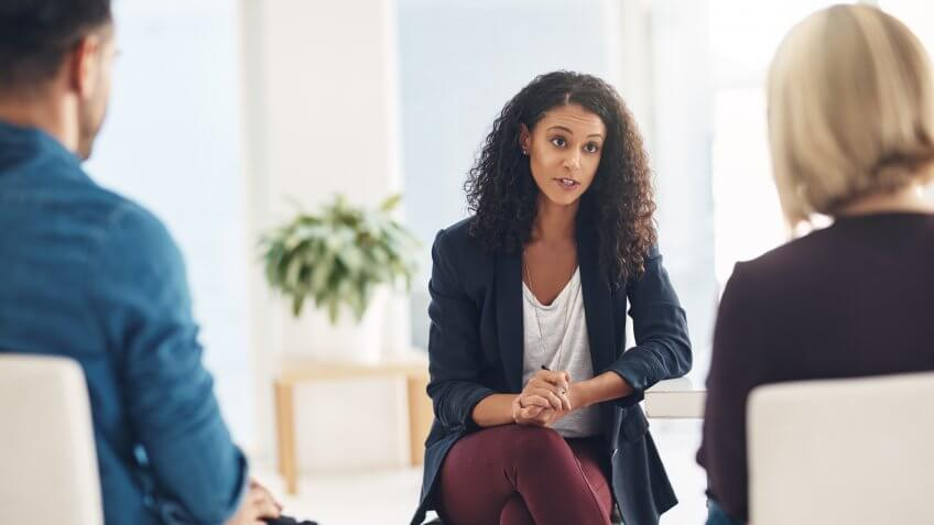 Therapist speaking to a couple during a counseling session