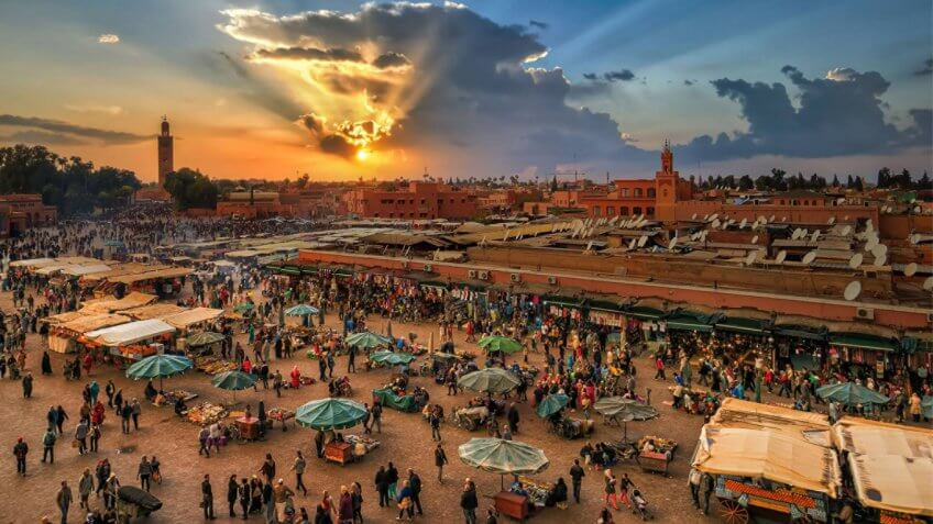 Bustling markets of Marrakech, Morocco at sunset
