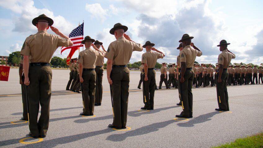 Dramatic shot of Drill Instructors saluting the U.