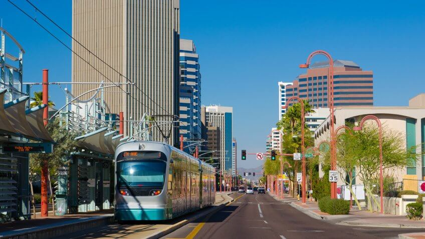 Midtown Phoenix business district with a light rail line and train in the foreground.