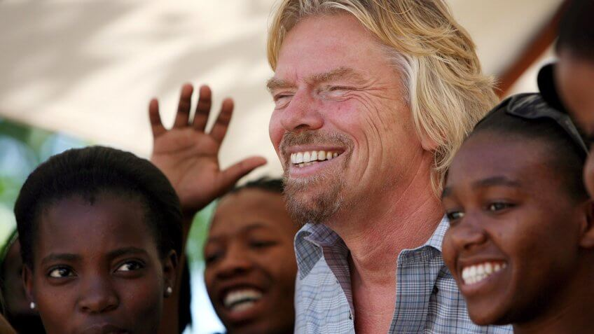 Mandatory Credit: Photo by Jon Hrusa/EPA/REX/Shutterstock (7867229b)British Billionaire Entrepeneur Sir Richard Branson Shares a Laugh with Students at the Cida City Campus in Johannesburg South Africa Wednesday 25 October 2006 Branson Attended the Launch of the 'Women On the Move' Programme at the Campus Which is Funded by Virgin Unite Branson's Independent Arm of the Virgin GroupSouth Africa Branson Charity - Oct 2006.