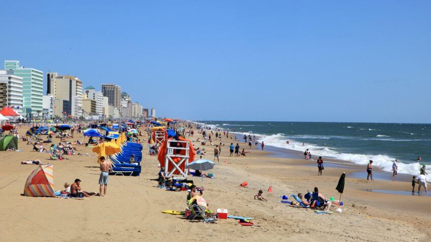 Virginia Beach City resort with tourist on the beach's enjoying a summer day.