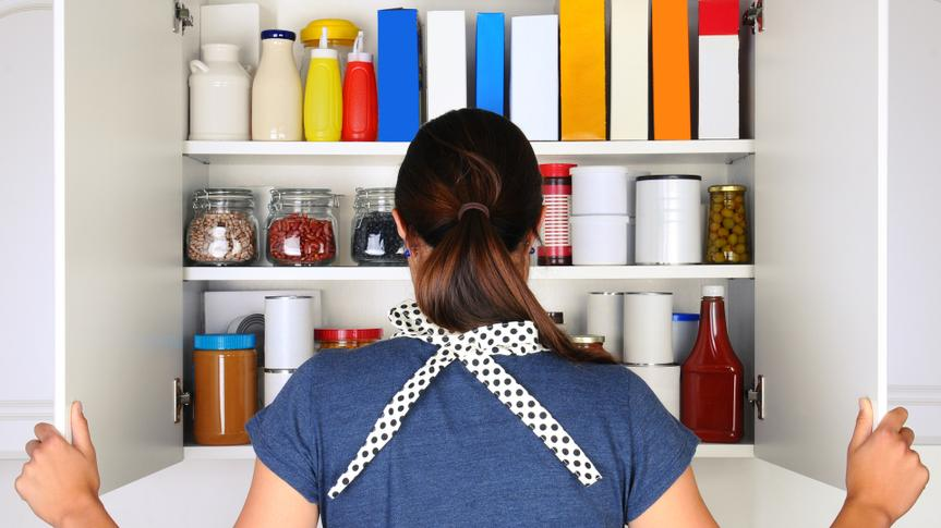 Woman looking into cupboard pantry