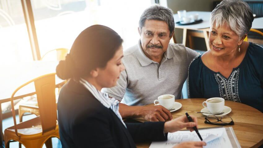 Shot of a senior couple meeting up with a financial advisor.