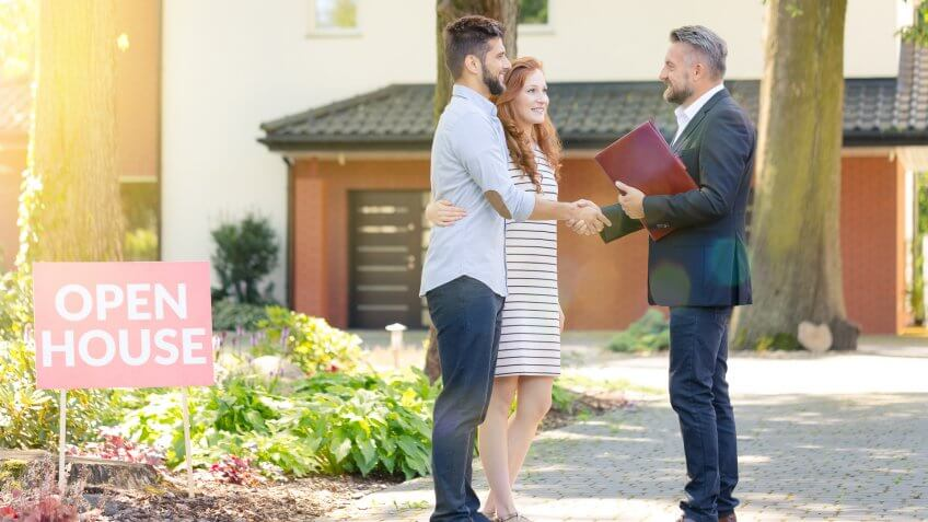 couple meeting with realtor