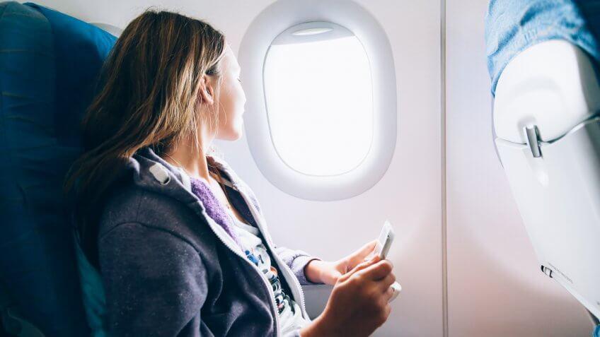 girl sitting on airplane