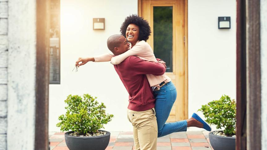 Shot of a young couple celebrating the move into their new house.