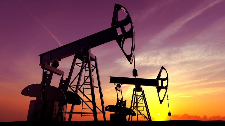Oil pump against sunset sky