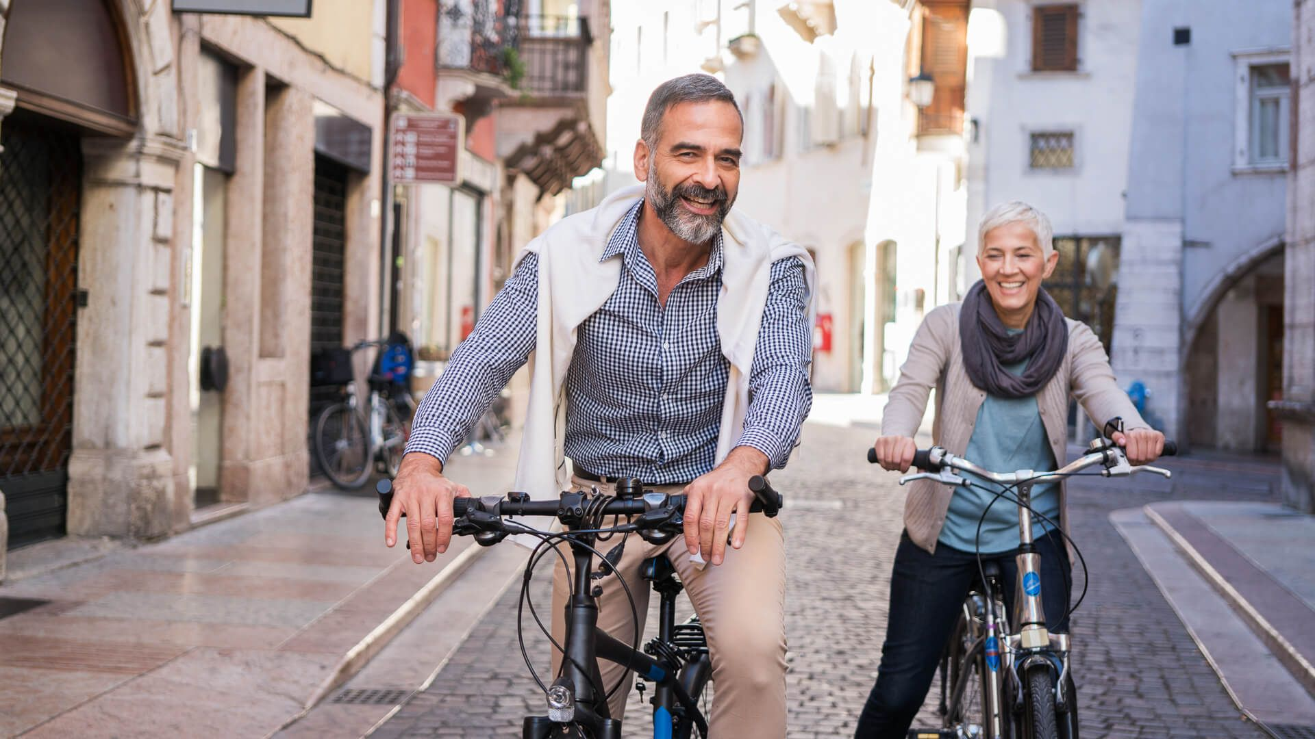 Mature couple exploring city with bicycle's.