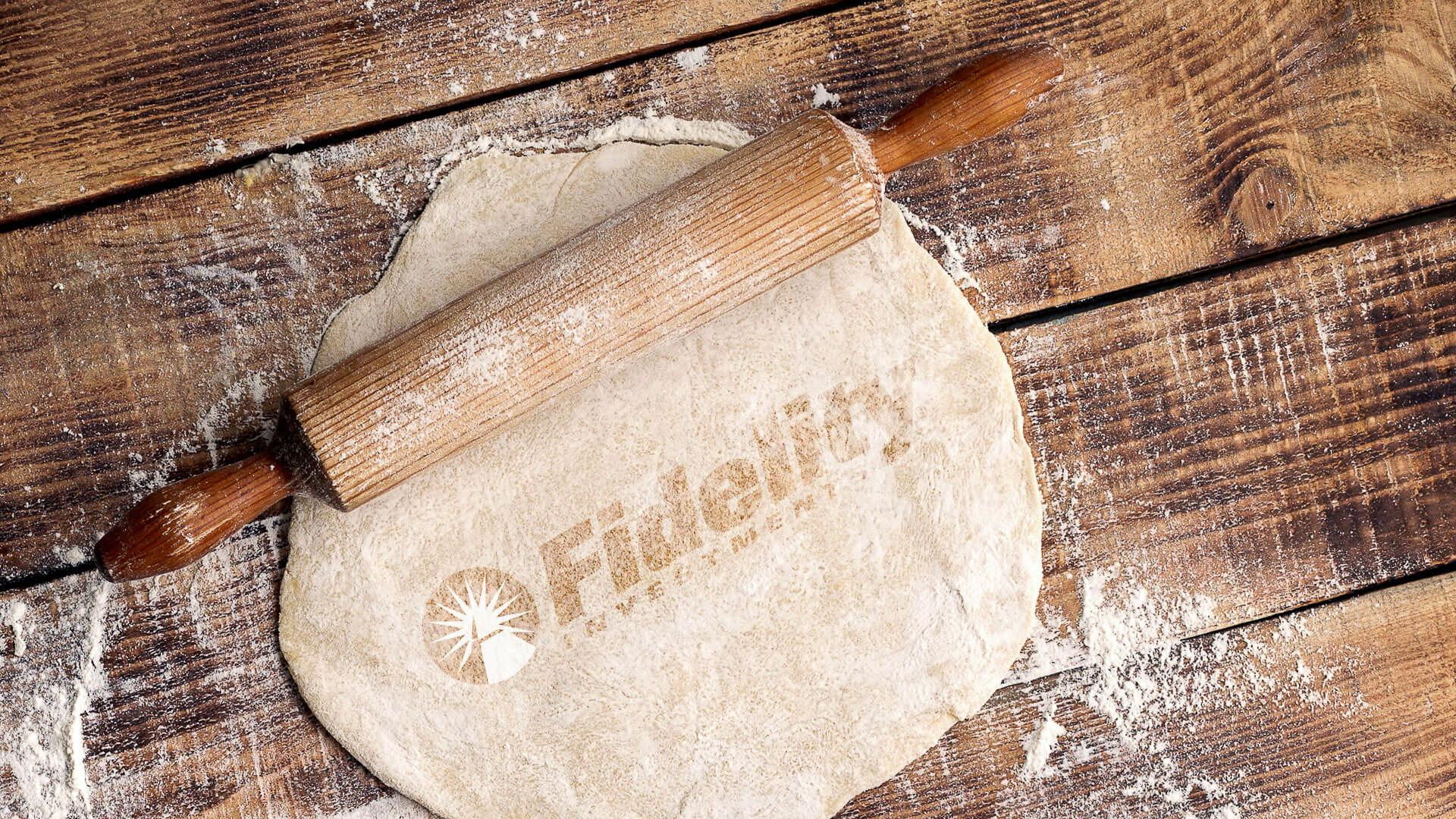 Fidelity Investments rolling pin with dough