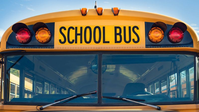 Front closeup view of a yellow school bus.