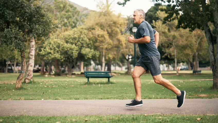 Shot of a senior man out for a run in the park.