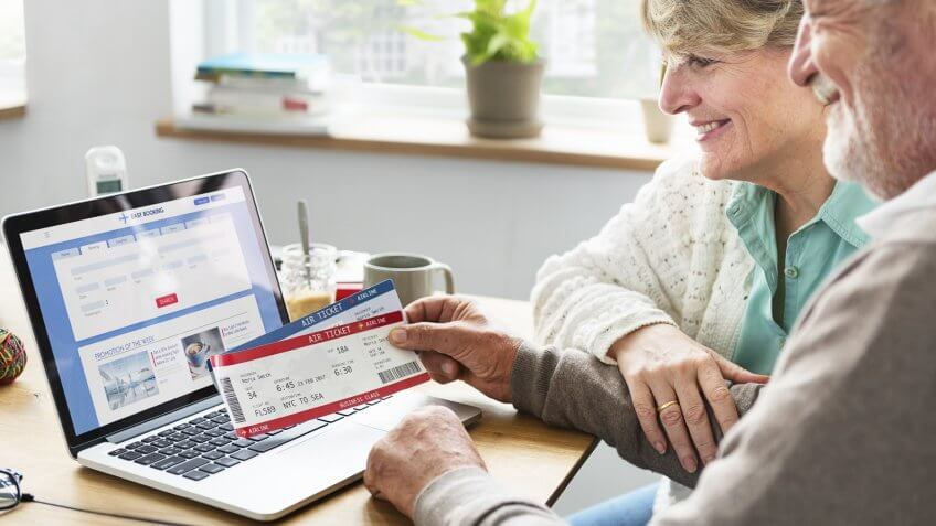 senior people with airplane tickets