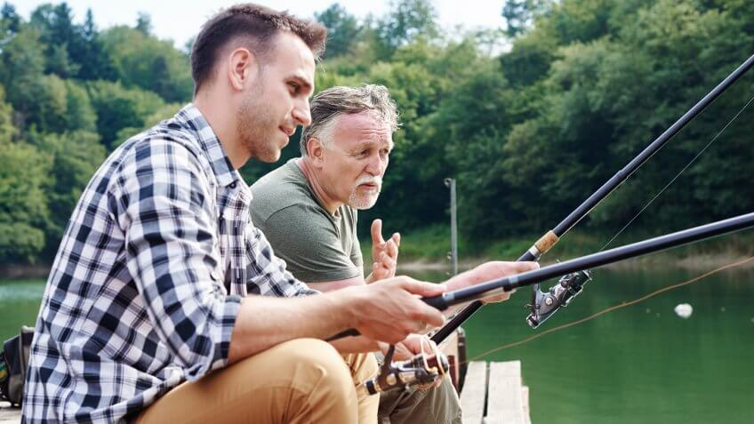 Men talking and fishing together.
