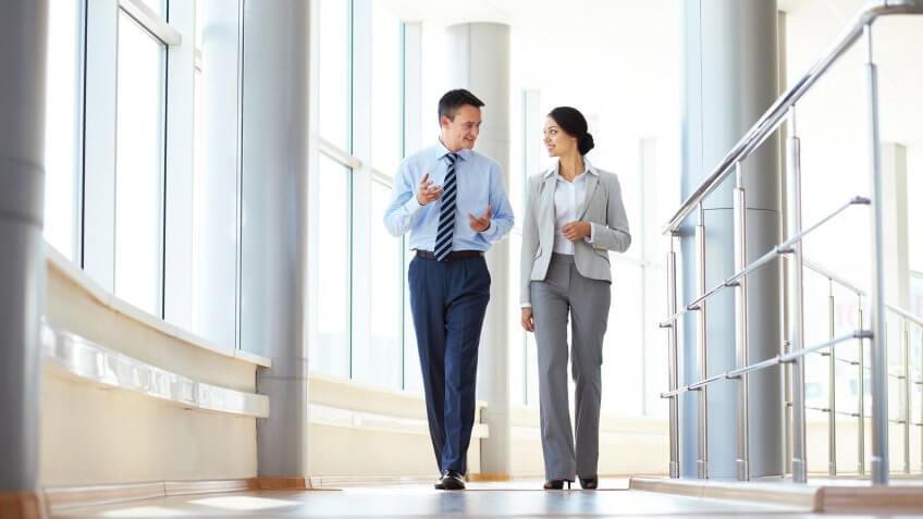 two financial investors walking