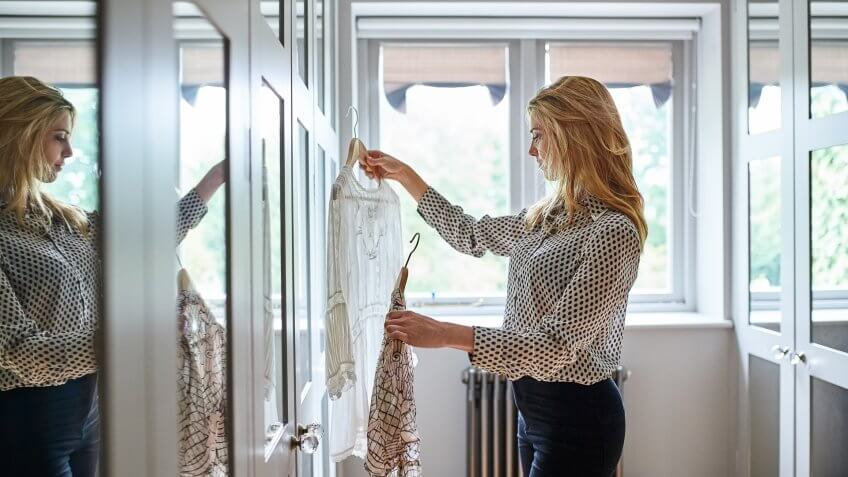 woman choosing outfit for work