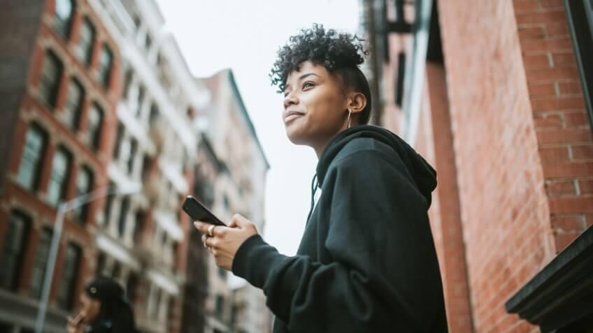 A young African American woman spends time in New York city, exploring Manhattan.