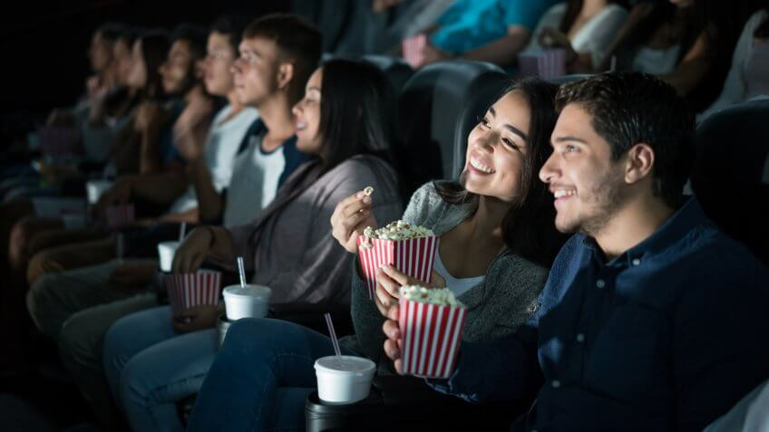 young couple watching movie in theater