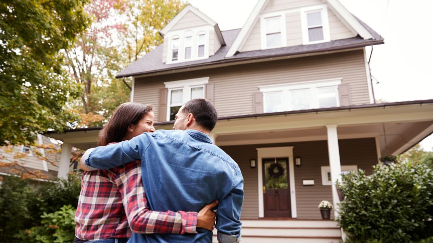 Rear View Of Loving Couple Walking Towards House.