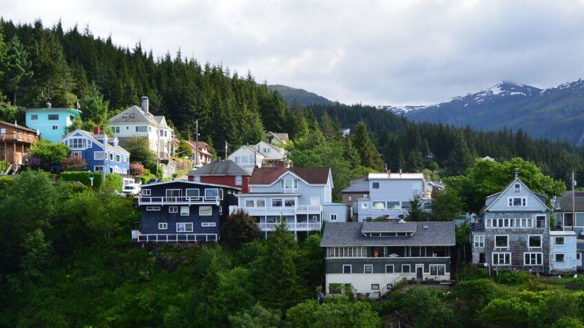 Many homes sit high on a ridge with a waterfront view of the port of Ketchikan in Alaska.
