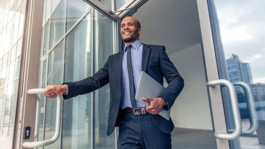 Businessman leaving office for the day