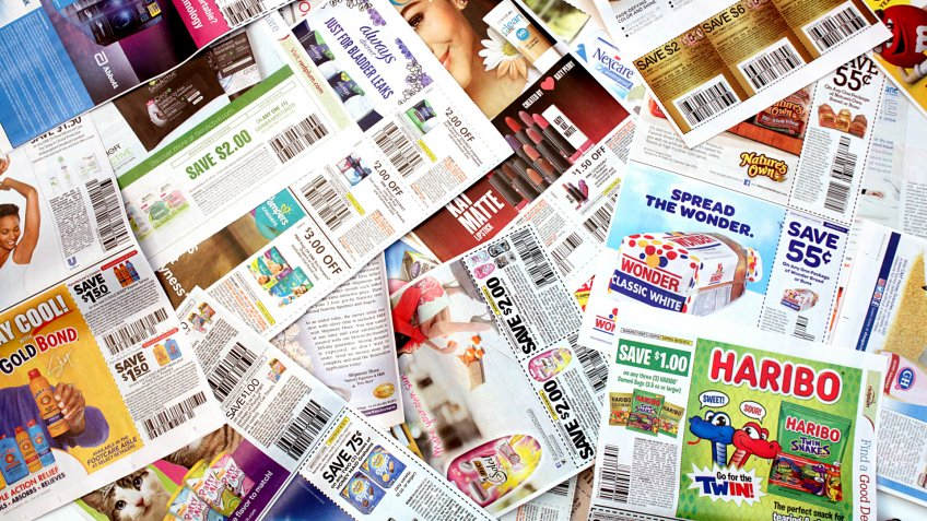 Colorado, USA - July 13, 2016: Studio shot of a pile of manufacturer coupons.