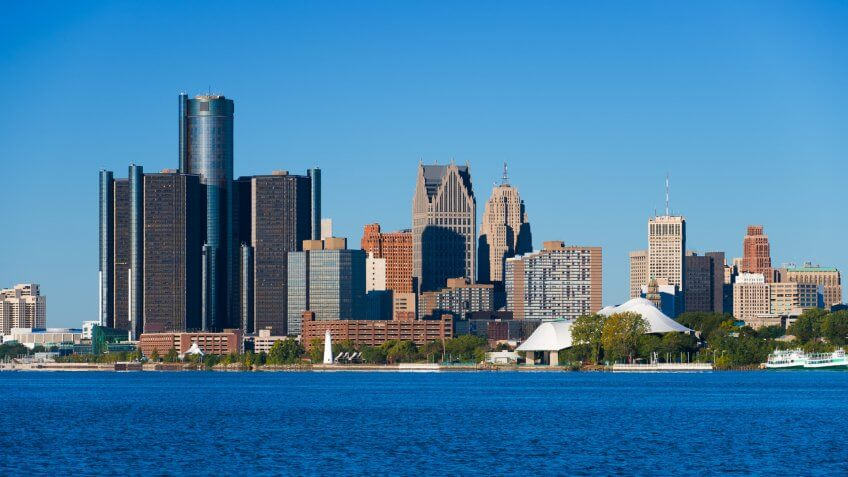 Downtown Detroit closeup skyline view with Detroit River in the foreground.
