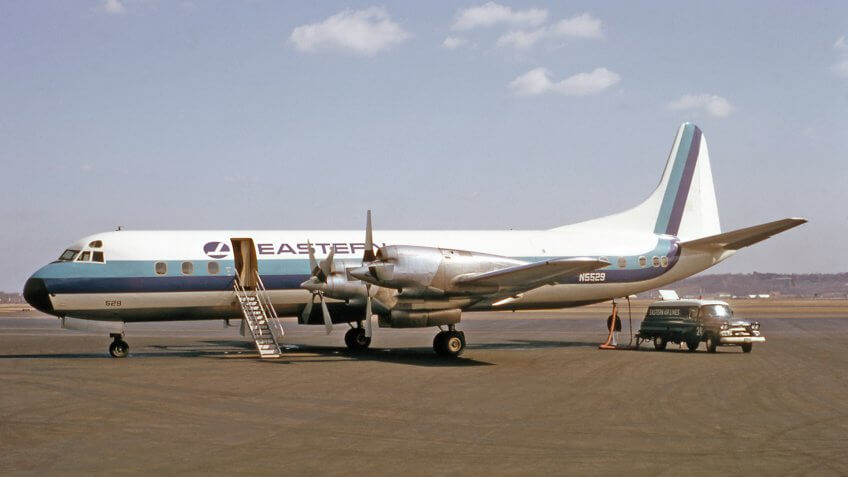 Eastern Airlines Lockheed L-188A Electra airplane being serviced for flight.