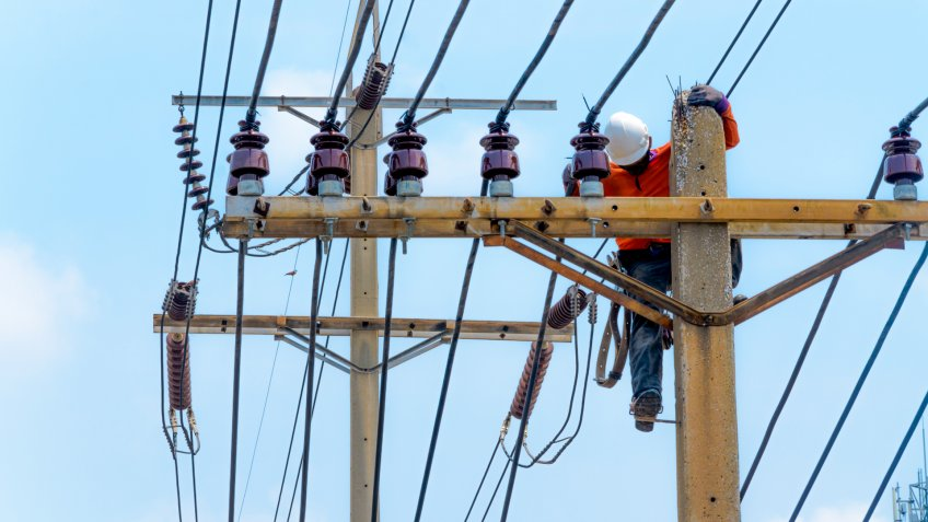 Electricity power-line installer making repairs