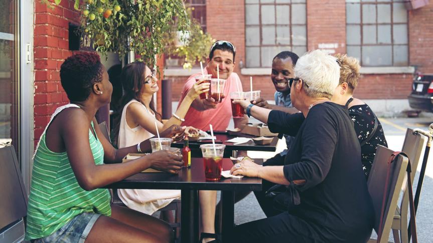 People enjoying food outside a restaurant