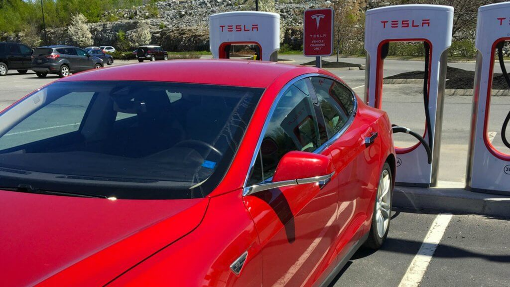 Influencer red tesla charging station Jordann Brown