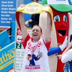 Mandatory Credit: Photo by Erik Pendzich/REX/Shutterstock (9735357ag) Joey Chestnut eats 74 hot dogs in 10 minutes Nathan's Famous Fourth of July Hot Dog Eating Contest, New York, USA - 04 Jul 2018.