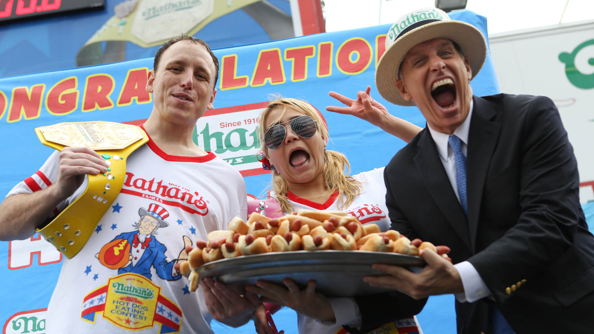 Mandatory Credit: Photo by Erik Pendzich/REX/Shutterstock (3890886af)Mens winner Joey Chestnut, womens winner Miki Sudo and George Shea, head of the IFOCE (International Federation of Competitive Eating.