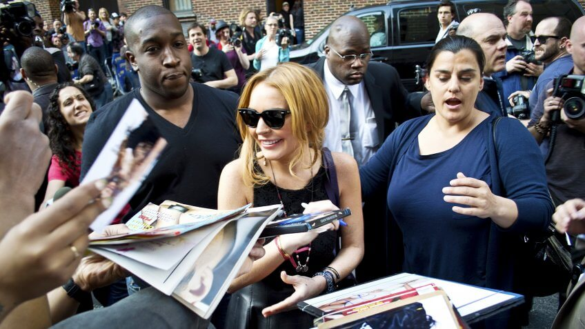 NEW YORK - APRIL 9: Lindsay Lohan greets fans after her David Letterman appearance outside the Ed Sullivan Theater on April 9, 2013 in Manhattan.