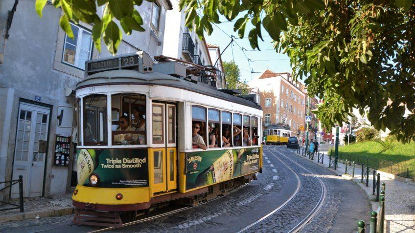 Lisbon, Portugal - September 1st, 2013: Classic yellow trams driving in Lisbon center.