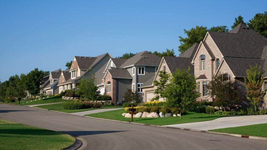 Nice upscale homes on suburban street.