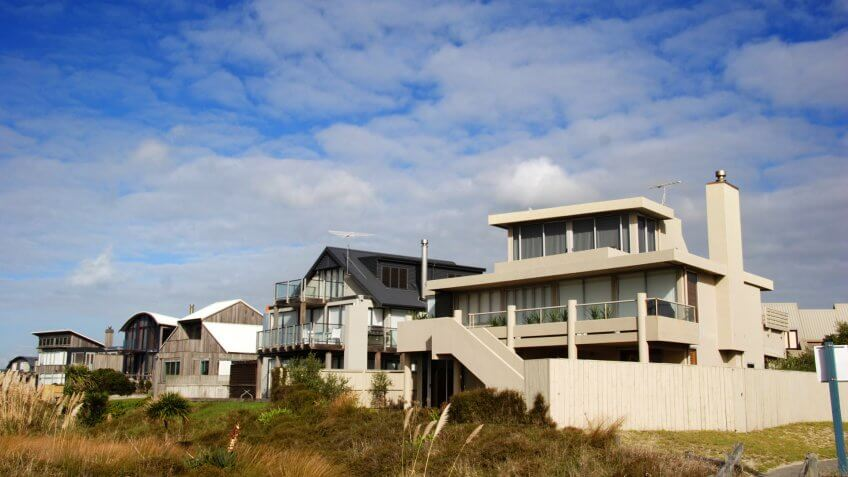 modern beach homes on a sunny day.