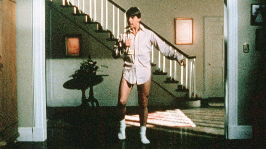 Photo by Warner Bros/Kobal/REX/Shutterstock (5883482t) Tom Cruise Risky Business - 1983 Director: Paul Brickman Warner Bros USA Scene Still