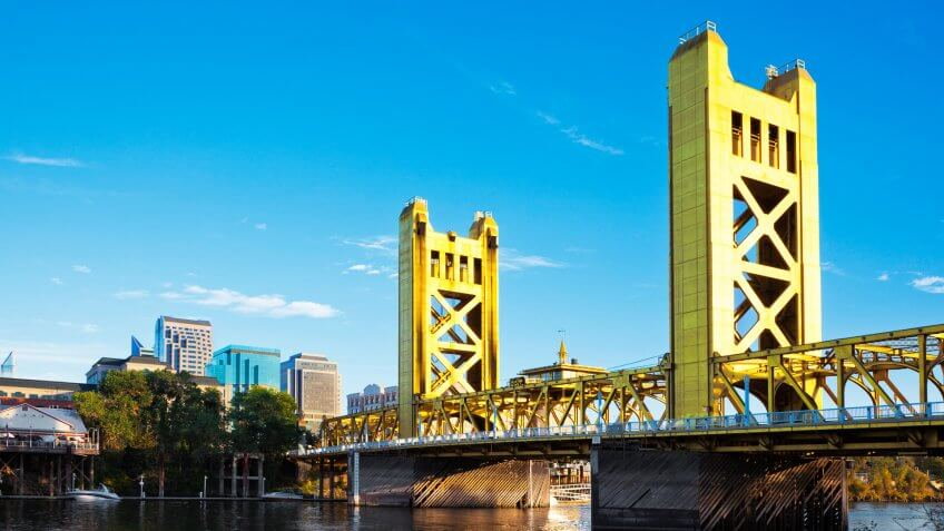 View at a Tower Bridge, a drawbridge built in 1935, and downtown Sacramento from West Sacramento side of the river.