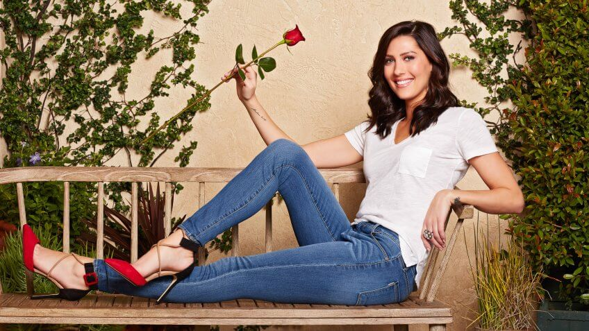 The Bachelorette's Becca Kufrin poses with rose